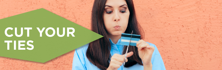 girl in blue shirt cutting up a debit card with the text cut your ties in a green diamond to the left of the image