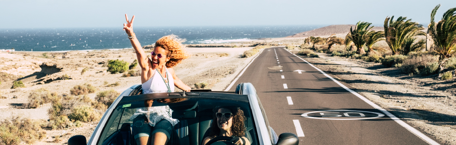 Woman in a convertible